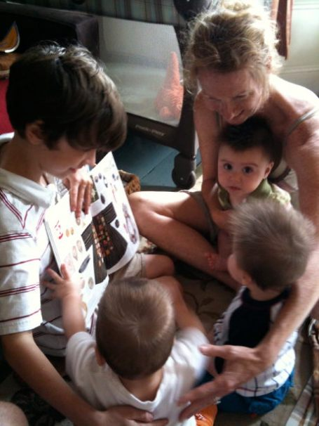 Liam and Sheila share a book with the gang